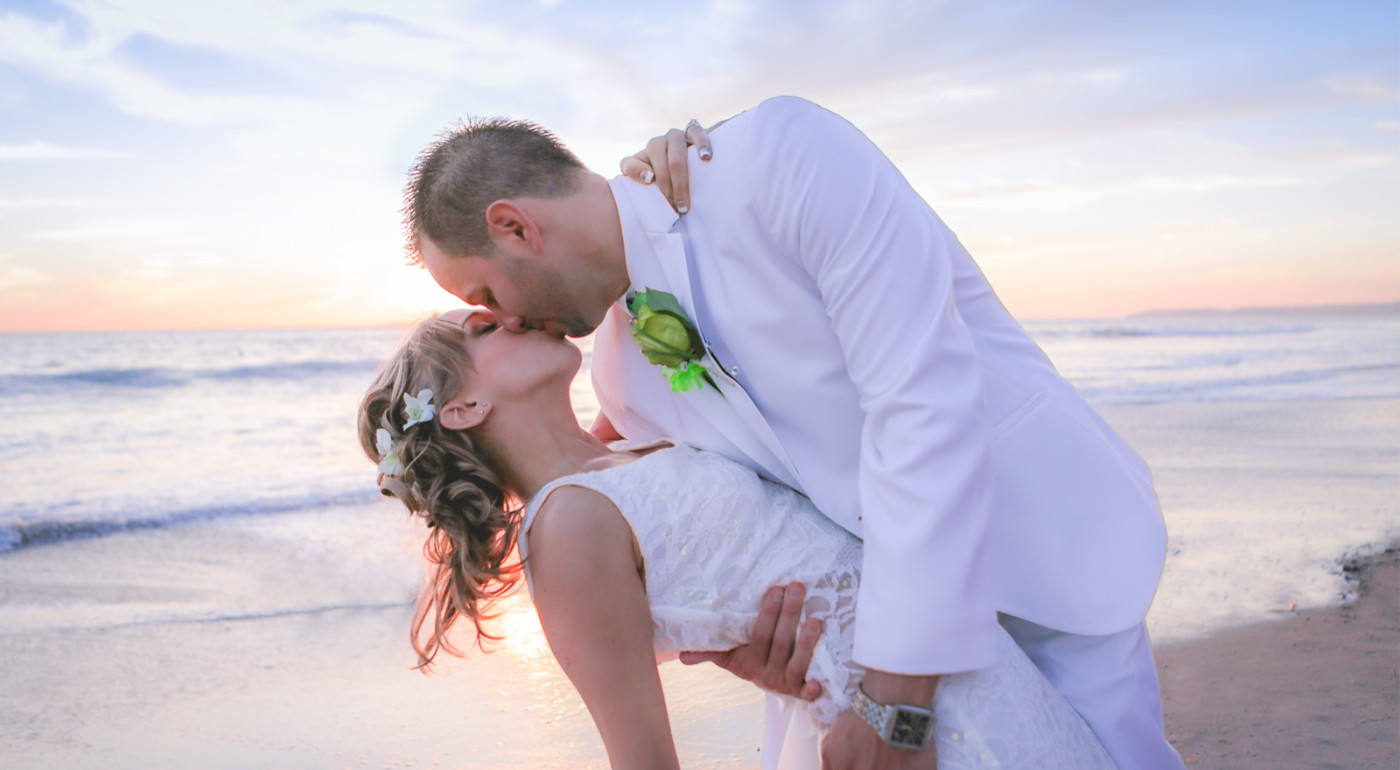 Beautiful Bride and Groom kissing on San Clemente Beach Wedding