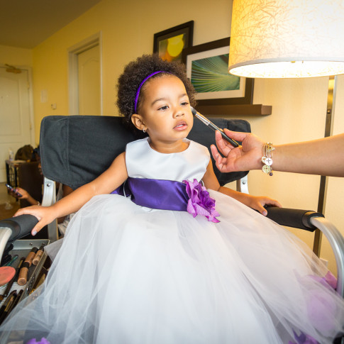 Beautiful Flower Girl getting her Makeup down before a wedding