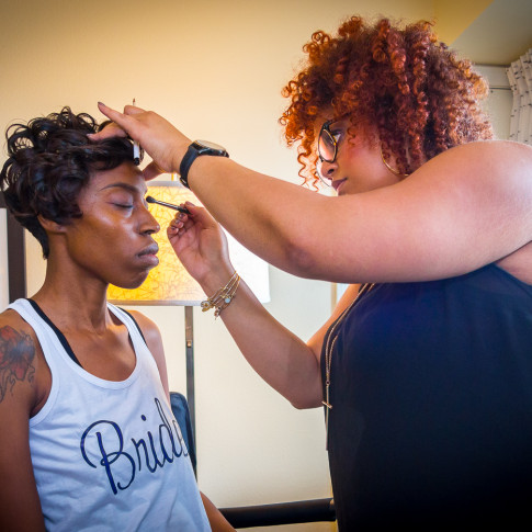 Amazing Bride having her makeup done before her Wedding
