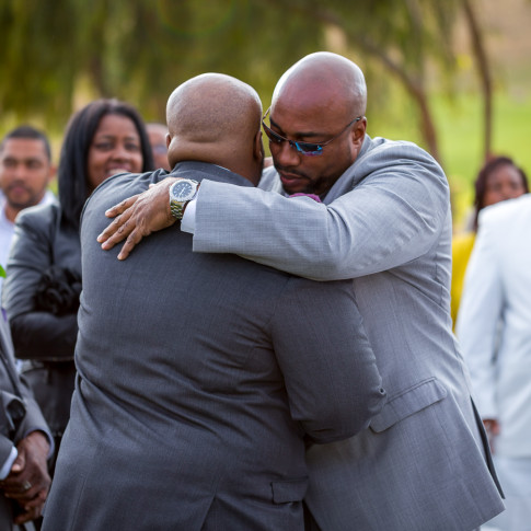 Groom hugging Brides Father before Marriage Ceremony