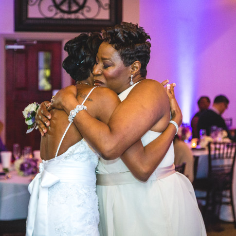 Beautiful Picture of the Mom and and Bride hugging at Reception