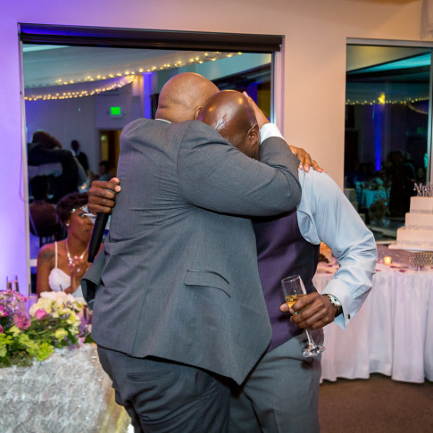 Groom and Best Man hugging after best man speech