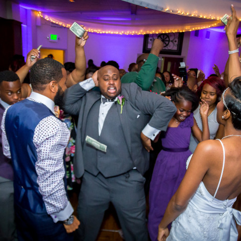 Funny picture of Groom Dancing while dollars are being thrown at Hidden Valley Golf Club