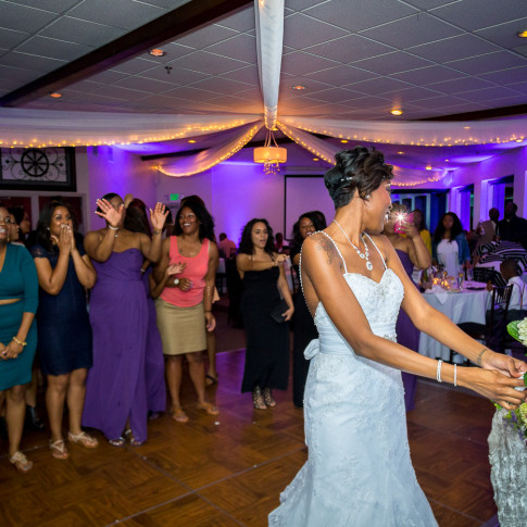 Black bride throwing bouquet at Hidden Valley Golf Course