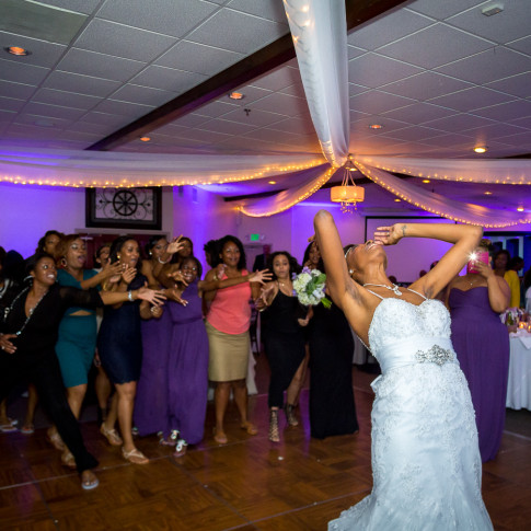 African American Bride throwing her Bouquet
