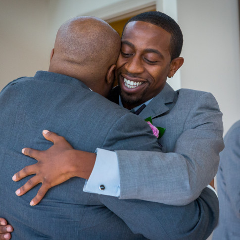 Best man hugging groom before wedding ceremony in Hidden Valley Golf Course, CA.