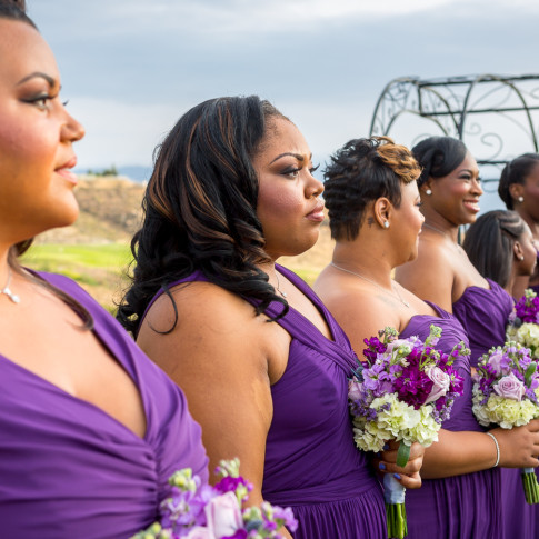 Bridesmaids at outdoor wedding ceremony at Hidden Valley Golf Course in Corona, CA.