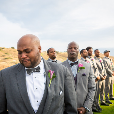 Emotional groom waiting for bride at outdoor wedding Hidden Valley Golf Course in Corona, CA.