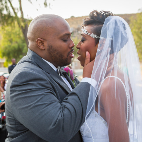 Black couple emotional first kiss outdoor wedding ceremony Hidden Valley Golf Course, Corona, CA.
