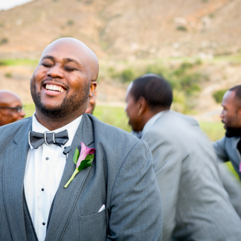 Laughing groom outdoor wedding Hidden Valley Golf Course, Corona, CA.