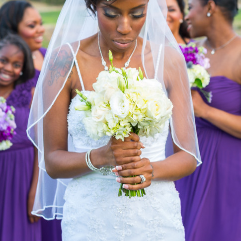 Beautiful black bride with bouquet at outdoor wedding ceremony Hidden Valley Golf Course, Corona, CA.