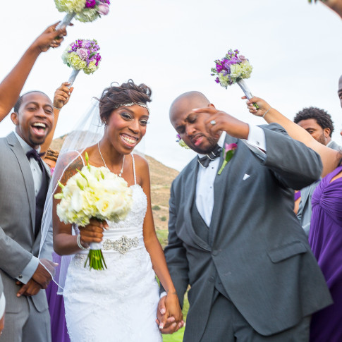 Happy black couple with wedding party outdoor wedding Hidden Valley Golf Course, Corona, CA.