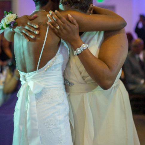 Beautiful Picture of the Black Mom and and Black Bride hugging at Reception