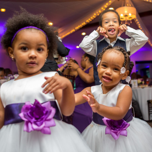 black kids making a funny face at a wedding