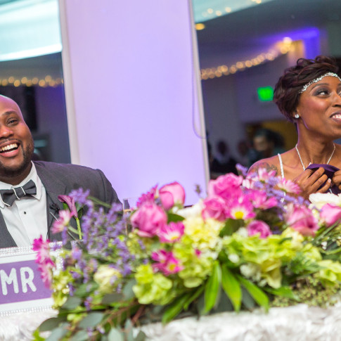 Black Bride and Groom Laughing as speeches are done