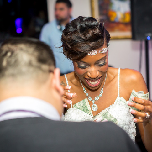 beautiful black bride getting those dollars at her reception