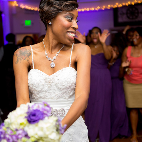 Beautiful Black Bride about throw her Bouquet
