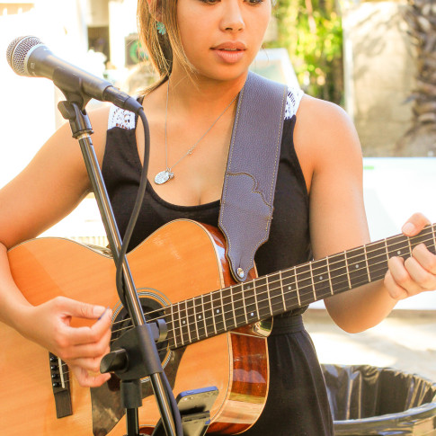 Singer at backyard engagement party in Dove Canyon