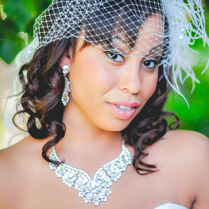 Beautiful black bride in bird cage veil at orange county mining co