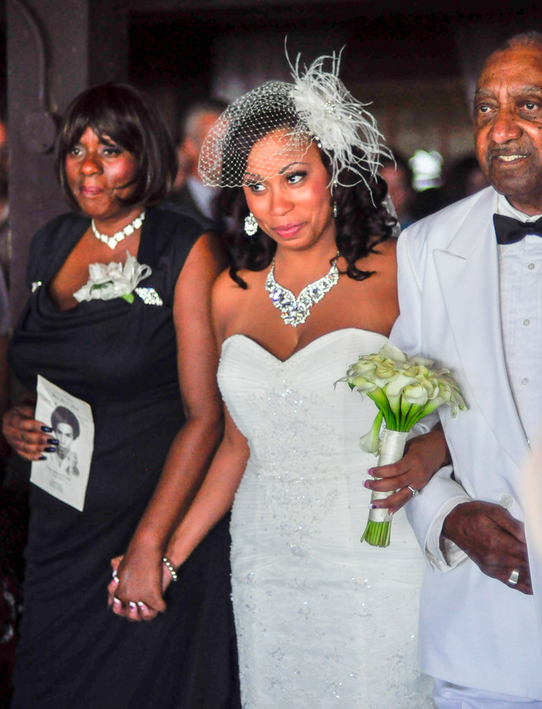 Mother and father walking bride down the aisle at orange county mining co