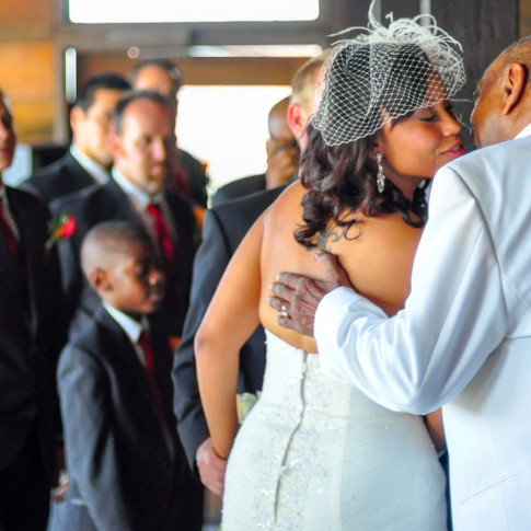 Father walking black bride down the aisle at orange county mining co
