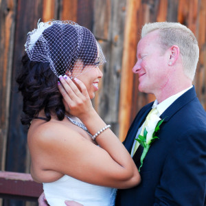 Bride and groom looking at each other at orange county mining co