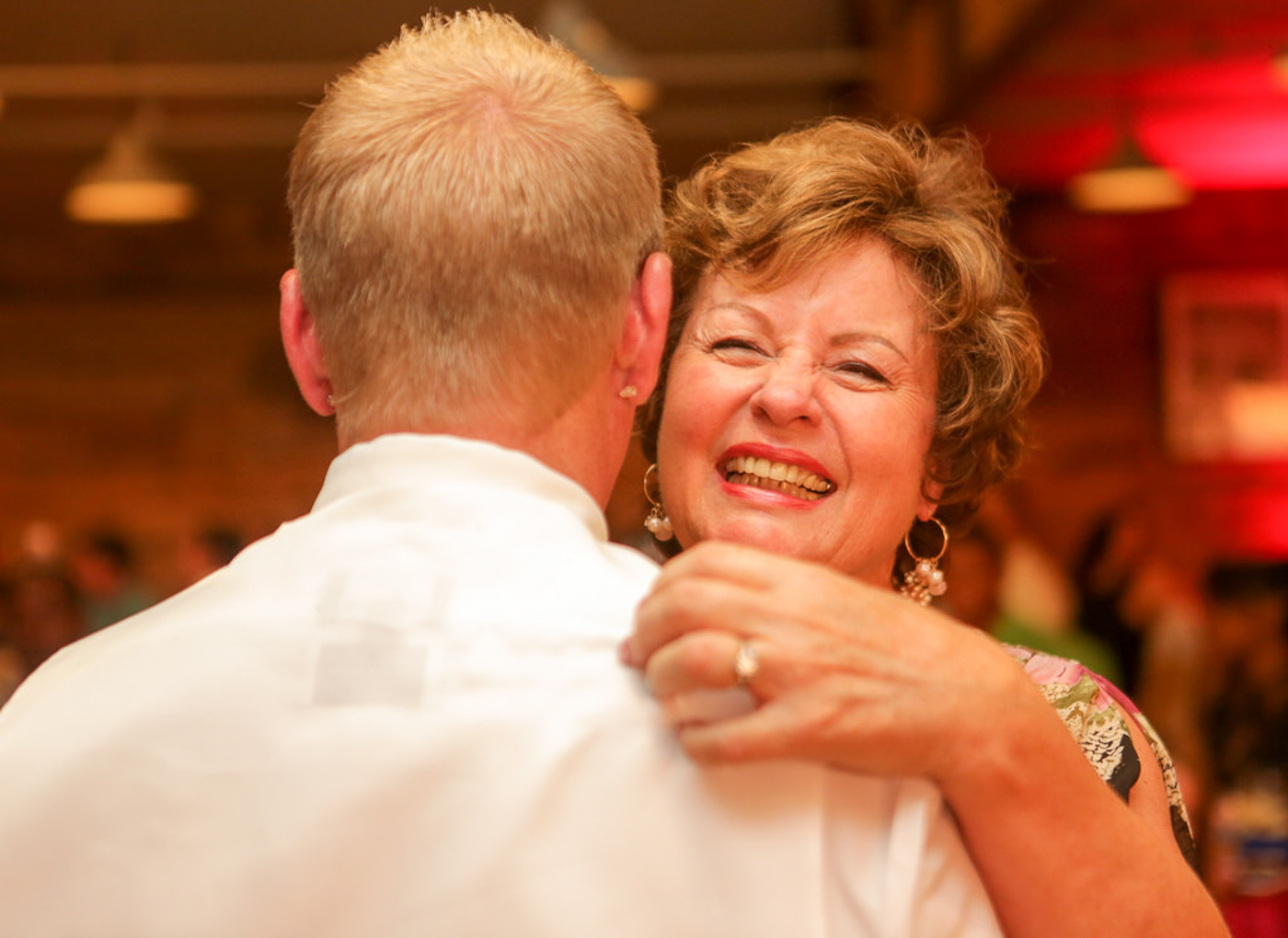 Happy mother during mother son dance at wedding in orange county, ca