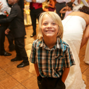 Cute boy at wedding reception at the orange county mining co
