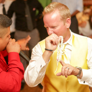 Groom throwing garter at wedding reception. Finally Forever Photography