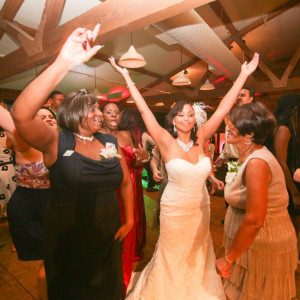 Bride and mother dancing at wedding reception at orange county mining co