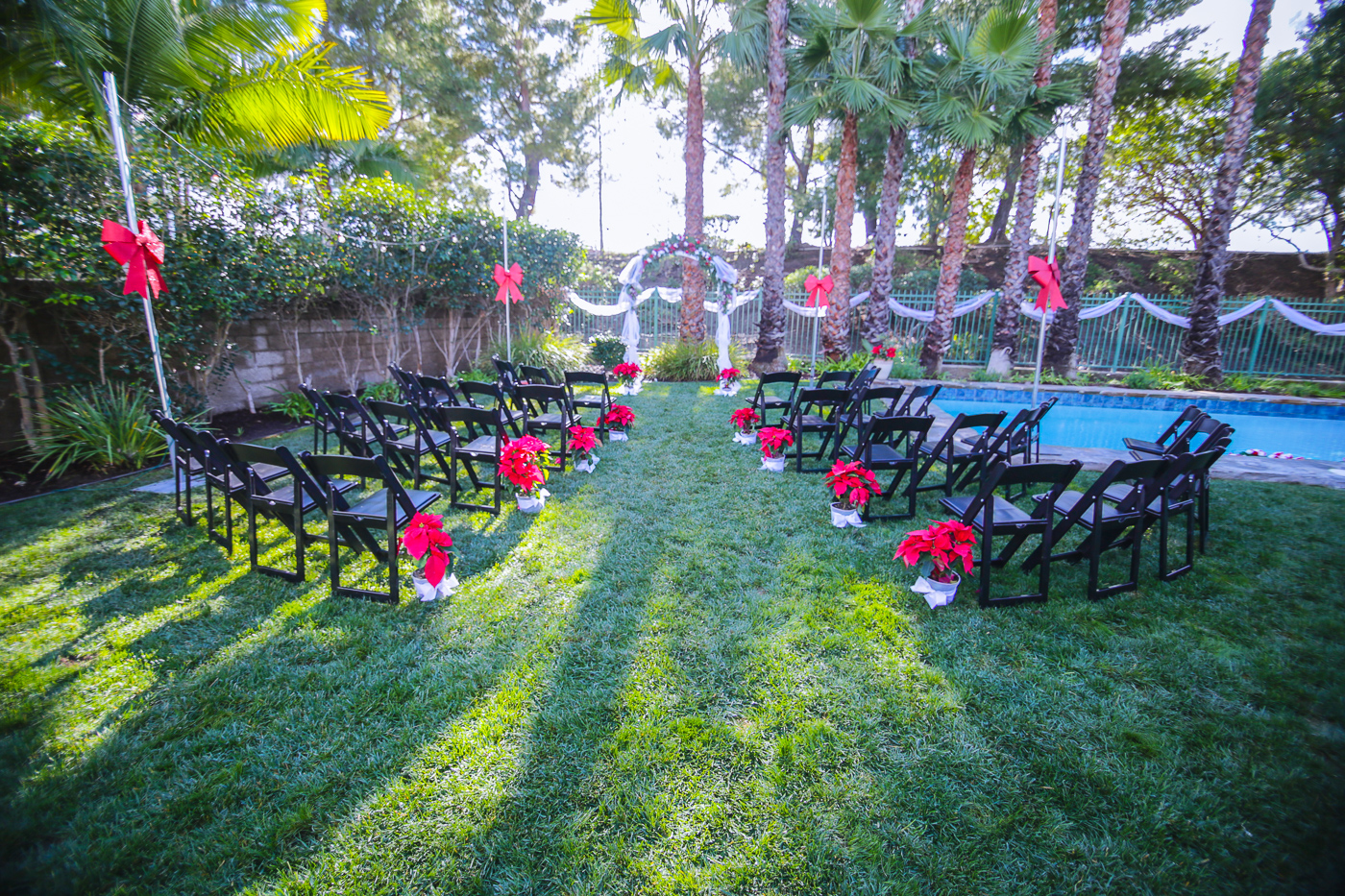 Beautiful Christmas themed backyard wedding ceremony setup