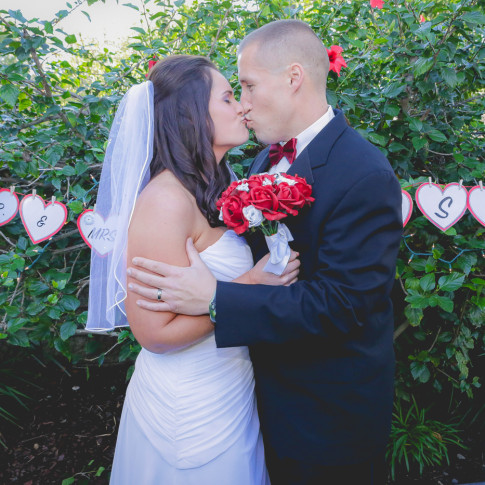 Couple kissing after backyard wedding ceremony