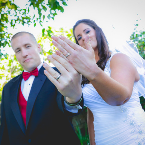 Bride and groom showing off beautiful wedding rings