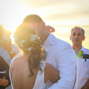 Couple during their first kiss at sunset San Clemente Beach. Finally Forever Photography