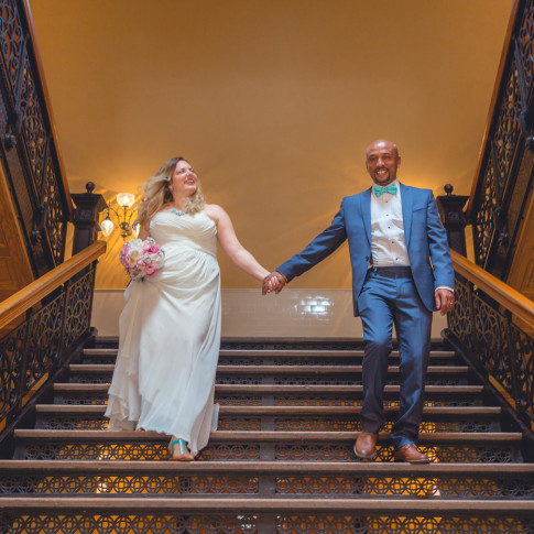 Beautiful courthouse wedding photo of couple walking down steps