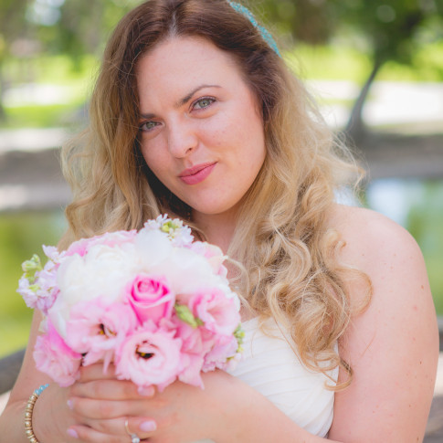 Bride showing off beautiful bouquet at Mile Square Park