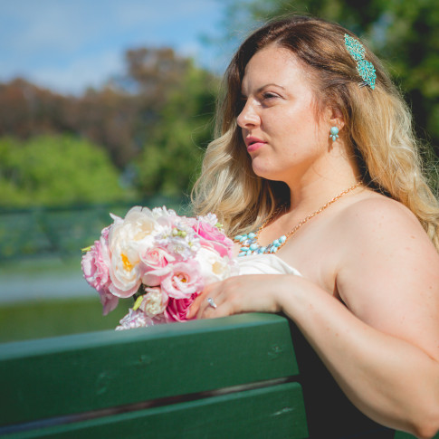 Bride sitting on bench at mile square park in garden grove