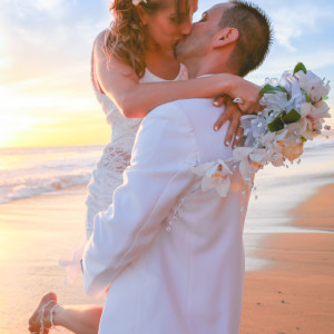 Couple kissing at sunset beach wedding at San Clemente beach wedding.