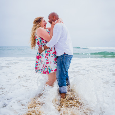 Beautiful beach engagement photos with waves at Huntington beach