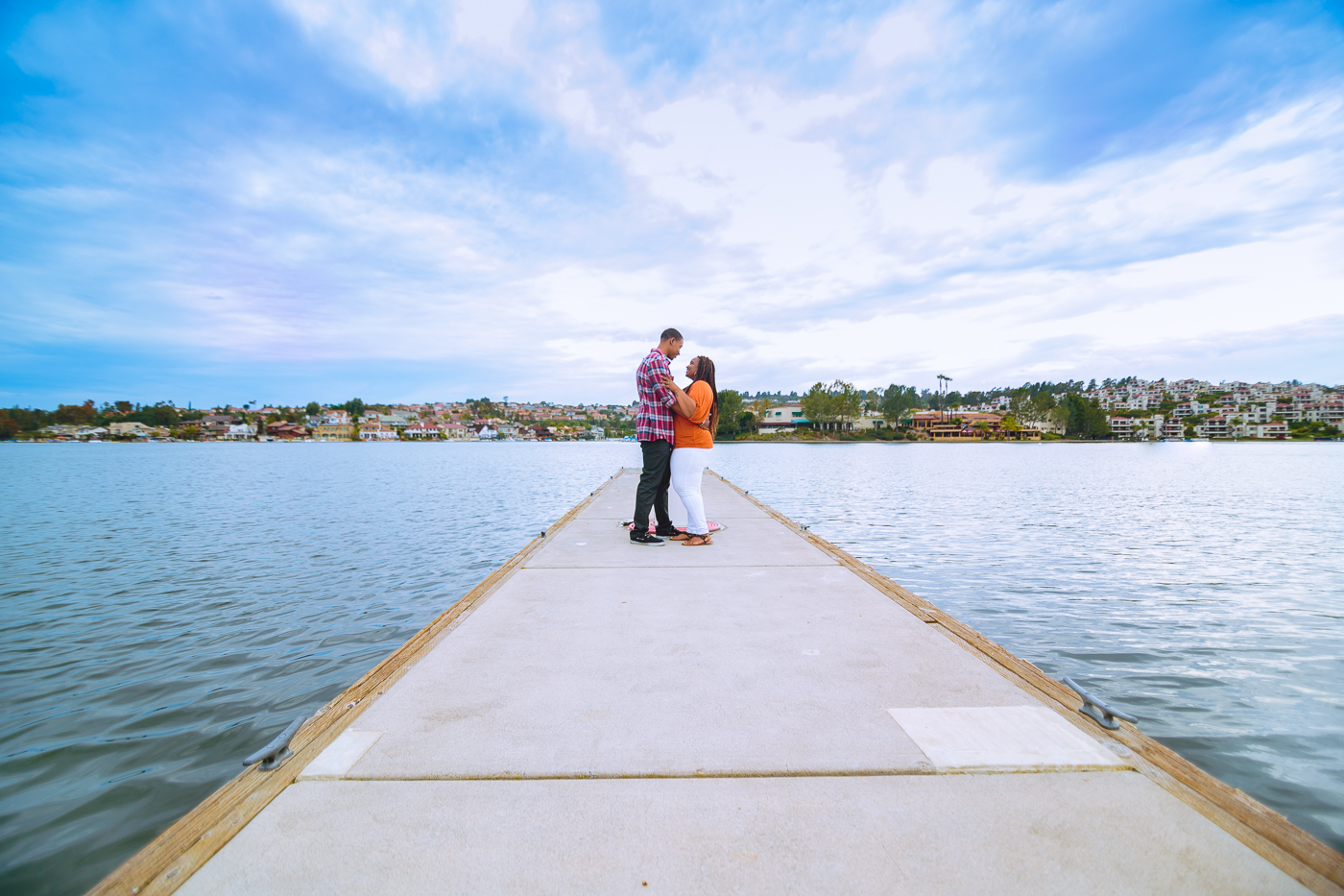 Engagement photo under blue sky and lake