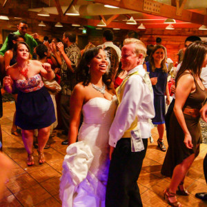 Bride and groom dancing at fun wedding reception at orange county mining co