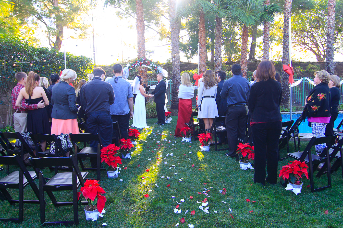 Beautiful Christmas themed backyard wedding ceremony