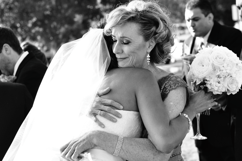 Bride's emotional embrace at wedding
