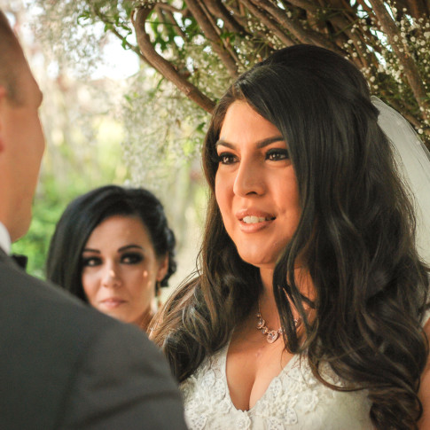 Bride looking at groom at outdoor wedding ceremony in Ventura, ca. finally forever photography