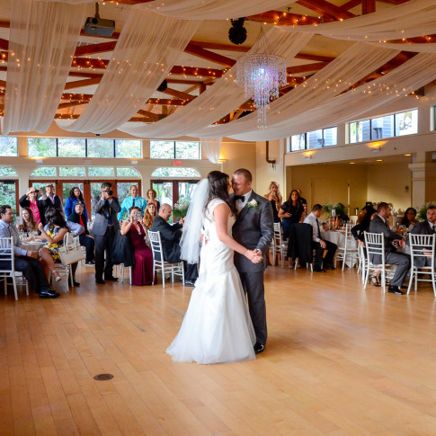 Guests take pictures and watch couple doing their first dance. The Pierpont Inn, Ventura, CA.