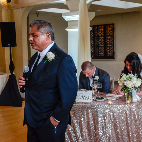 Father of the bride prays at wedding reception at the Pierpont Inn, Ventura, CA.