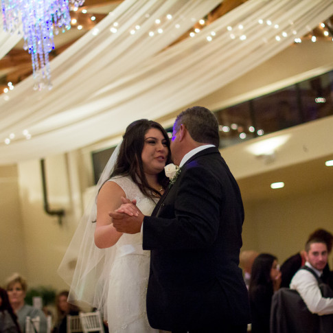 Emotional bride doing the father and daughter dance at a wedding reception The Pierpont Inn