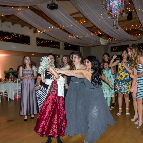 Singe ladies fight over bouquet at a fun wedding at the Pierpont Inn in Ventura, CA.