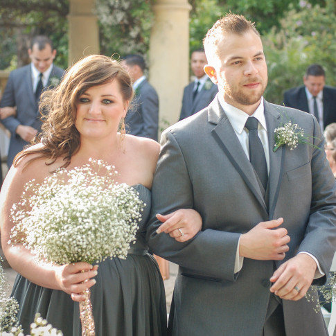 Bridesmaid and groomsman walking down the aisle after wedding ceremony. Finally Forever Photography