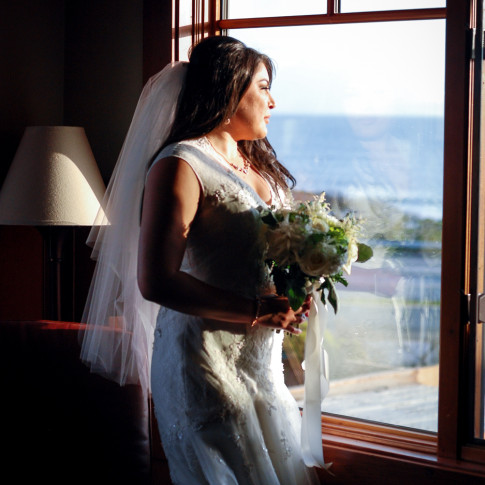 Beautiful bride looking out the window at the Pierpont Inn in Ventura, Ca. Finally Forever Photography